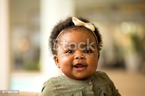 istock Portrait of a happy little girl laughing and smiling. 911983386