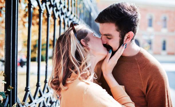 portrait of a happy loving couple. love, dating, romance - kiss стоковые фото и изображения