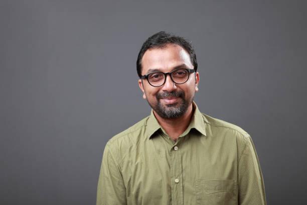 Portrait of a happy man of Indian origin stock photo