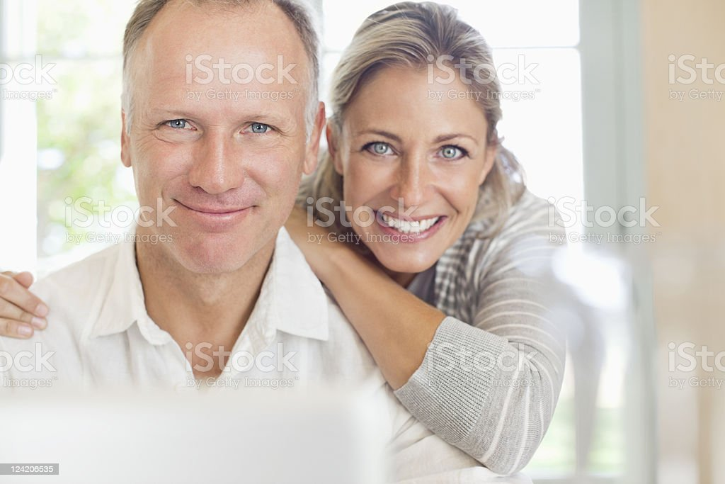 Portrait of a happy mature couple smiling stock photo
