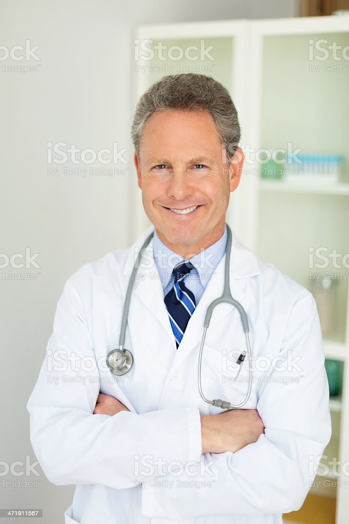 Portrait Of A Happy Mature Doctor royalty-free stock photo