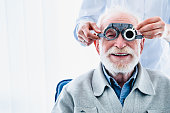istock Portrait of a happy mature male patient undergoing vision check with special ophthalmic glasses 1279371084