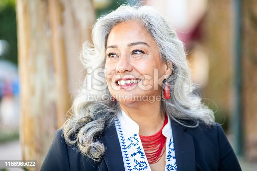 A mature Mexican businesswoman smiling