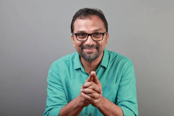 Portrait of a happy middle aged man of Indian ethnicity stock photo