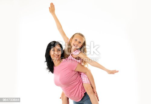 Portrait Of A Happy Mother And Cute Blonde Little Girl Hugging And Looking Cheerful At The Camera In Studio On White Background Happy Family And Good And Positive Parent And Child Relationship Stock Photo & More Pictures of Adult