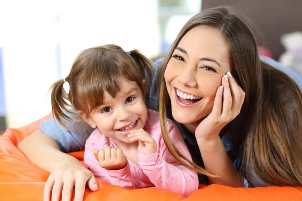 Portrait of a happy mother and daughter stock photo