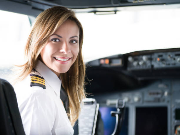 Portrait of a happy pilot in the airplane's cockpit Portrait of a happy pilot in the airplane's cockpit looking at the camera smiling before take off - travel concepts pilot stock pictures, royalty-free photos & images