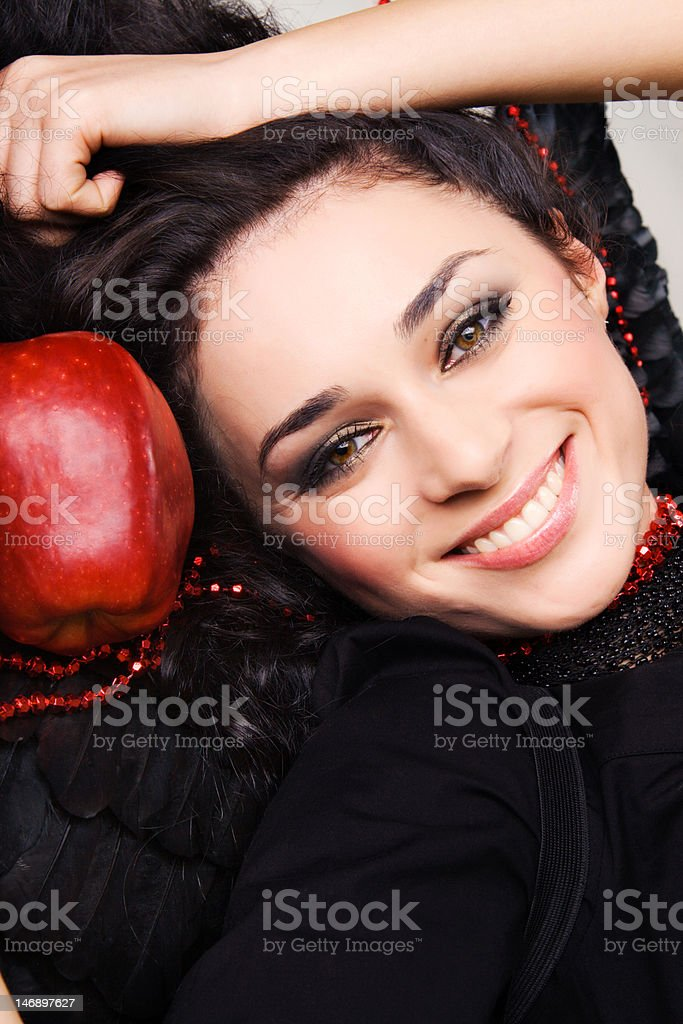 Portrait of a happy pretty brunette with big red apple royalty-free stock photo