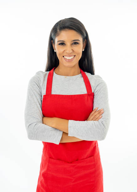 portrait of a happy proud beautiful latin woman wearing a red apron learning to cook making thumb up gesture in cooking classes small business and homemade spanish food concept isolated on white - apron stock pictures, royalty-free photos & images