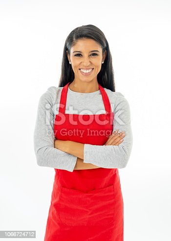 istock Portrait of a happy proud beautiful latin woman wearing a red apron learning to cook making thumb up gesture in cooking classes small business and homemade spanish food concept isolated on white 1066724712