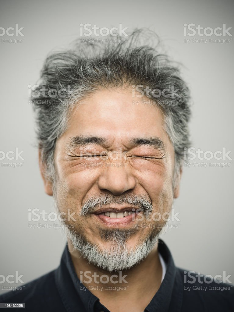 Portrait of a happy real japanese man with grey hair. stock photo