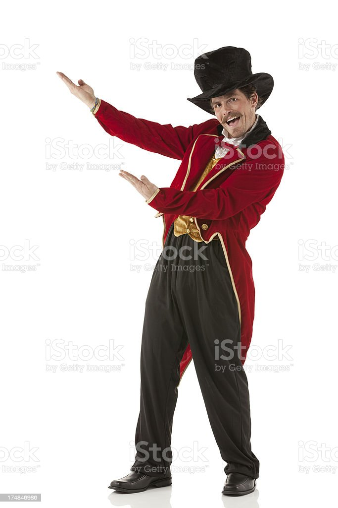 Portrait of a happy ringmaster gesturing stock photo