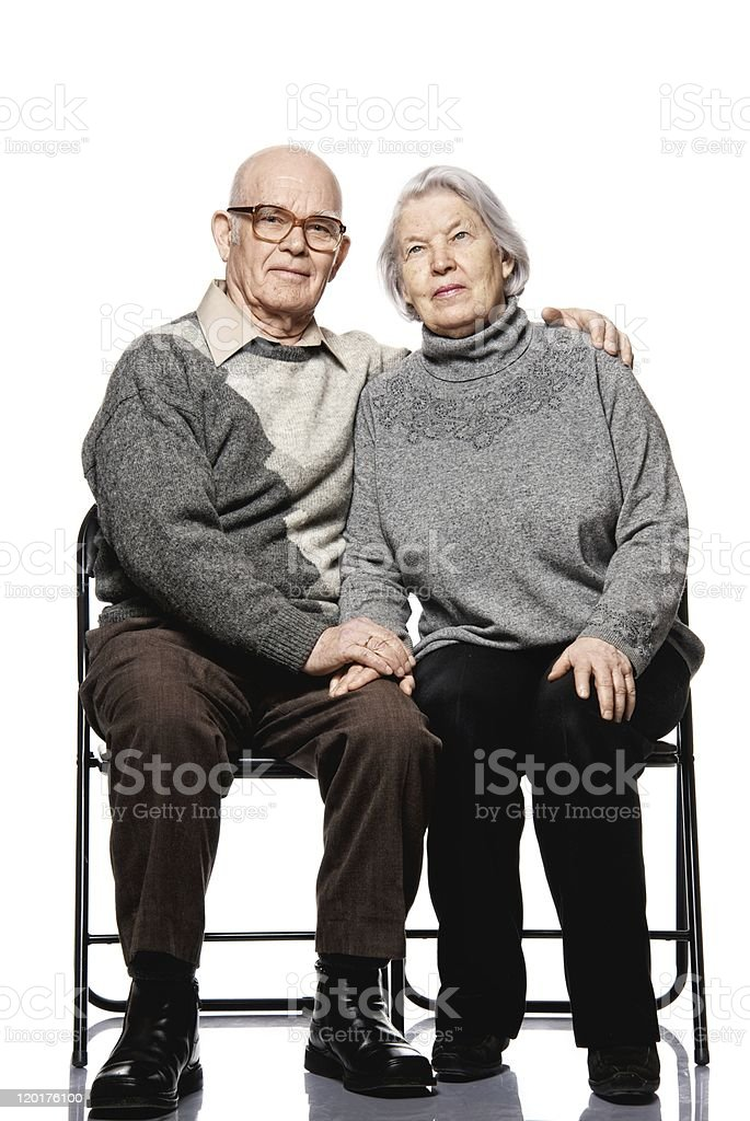 Portrait of a happy senior couple embracing each other stock photo