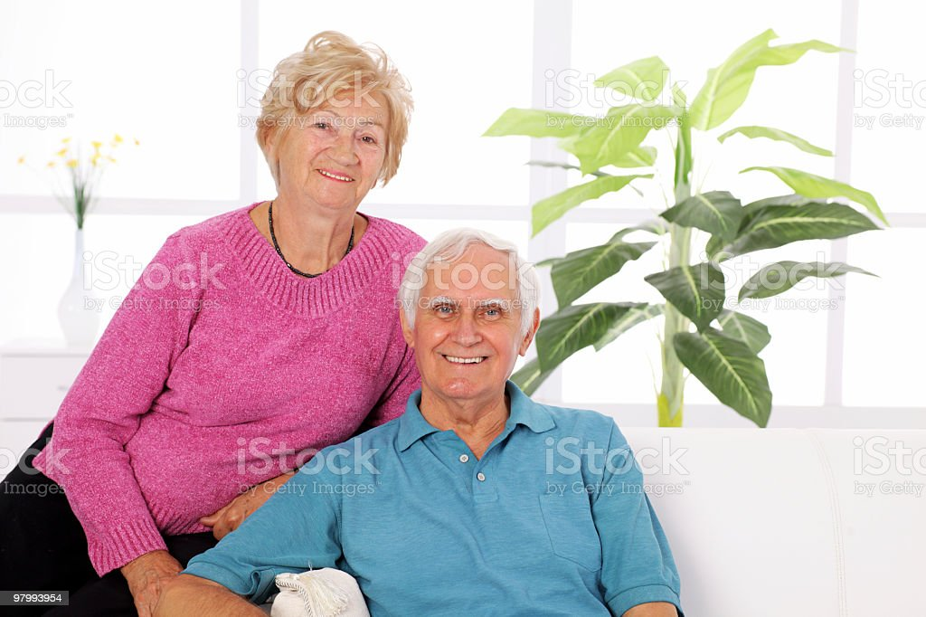 Portrait of a happy senior couple sitting together. royalty free stockfoto