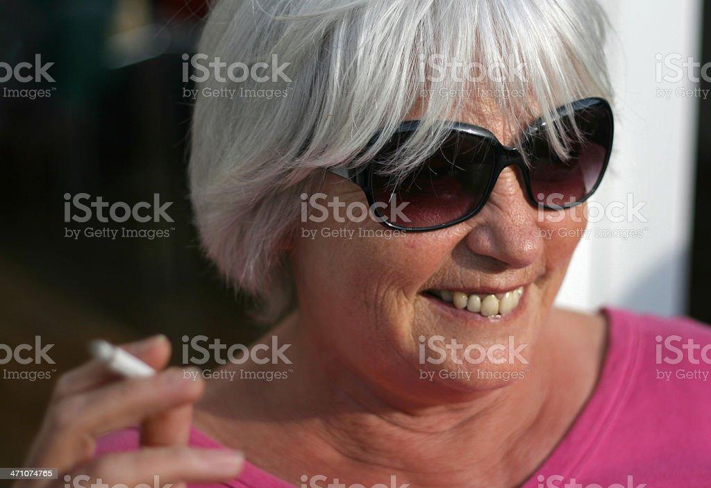 Portrait of a happy Senior Woman Smoking royalty-free stock photo