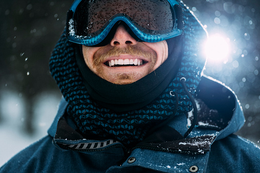 Portrait of a happy snowboarder