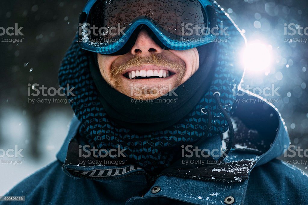 Portrait of a happy snowboarder stock photo