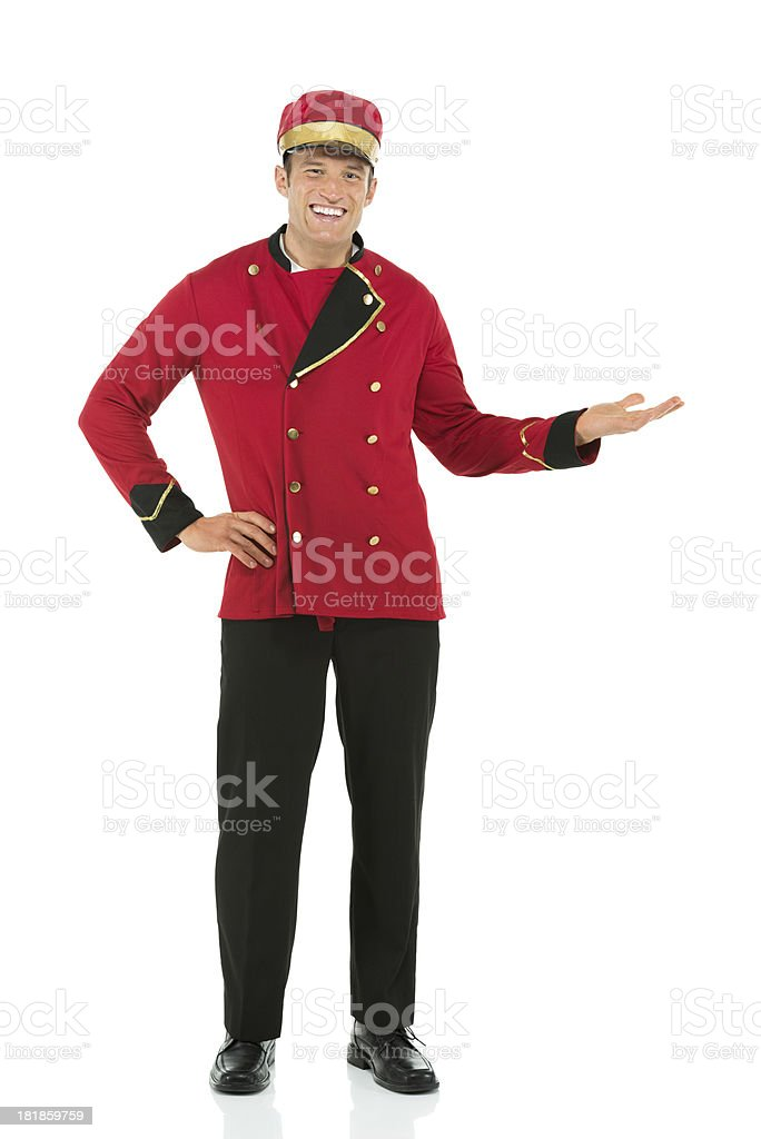 Portrait of a happy valet gesturing stock photo