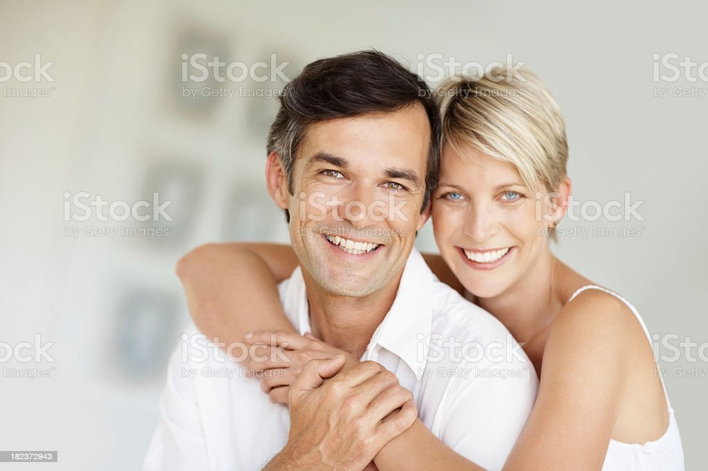 Portrait of a happy woman embracing her husband  stock photo