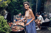 istock Portrait of a happy woman making barbecue 1296196477