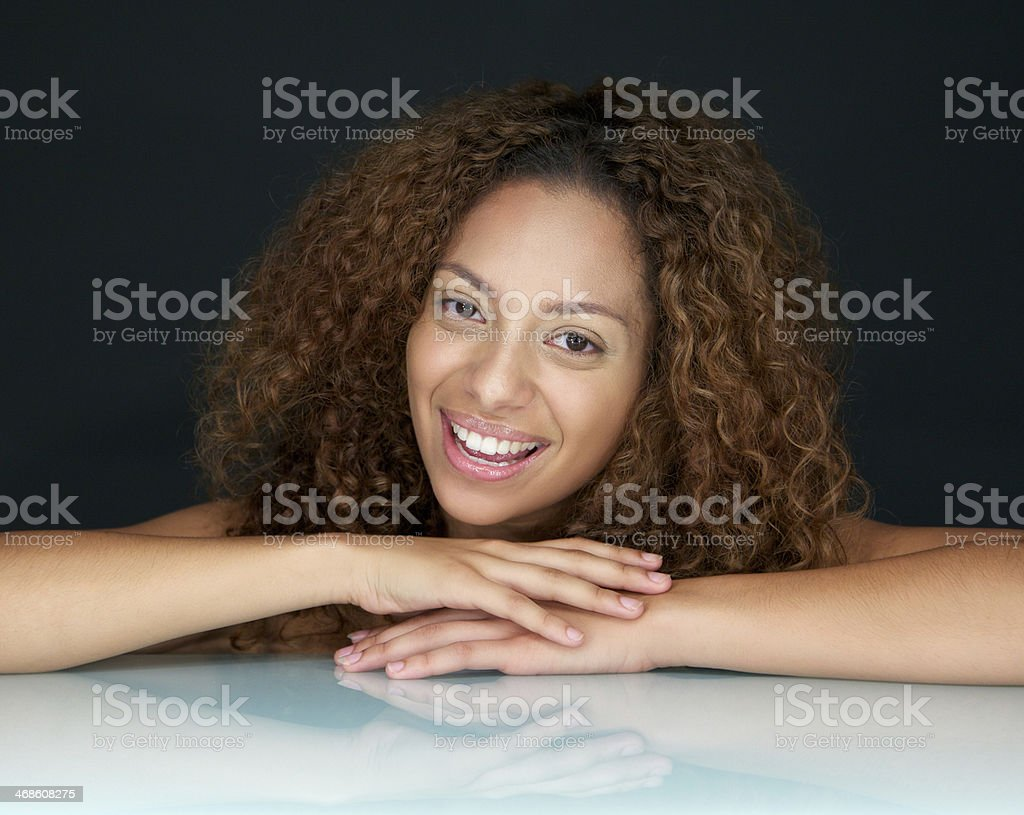 Portrait of a happy woman smiling with curly hair royalty-free stock photo