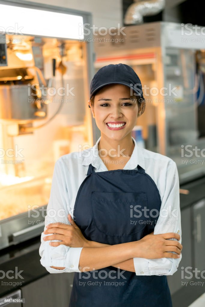 Portrait of a happy woman working at the cinema stock photo