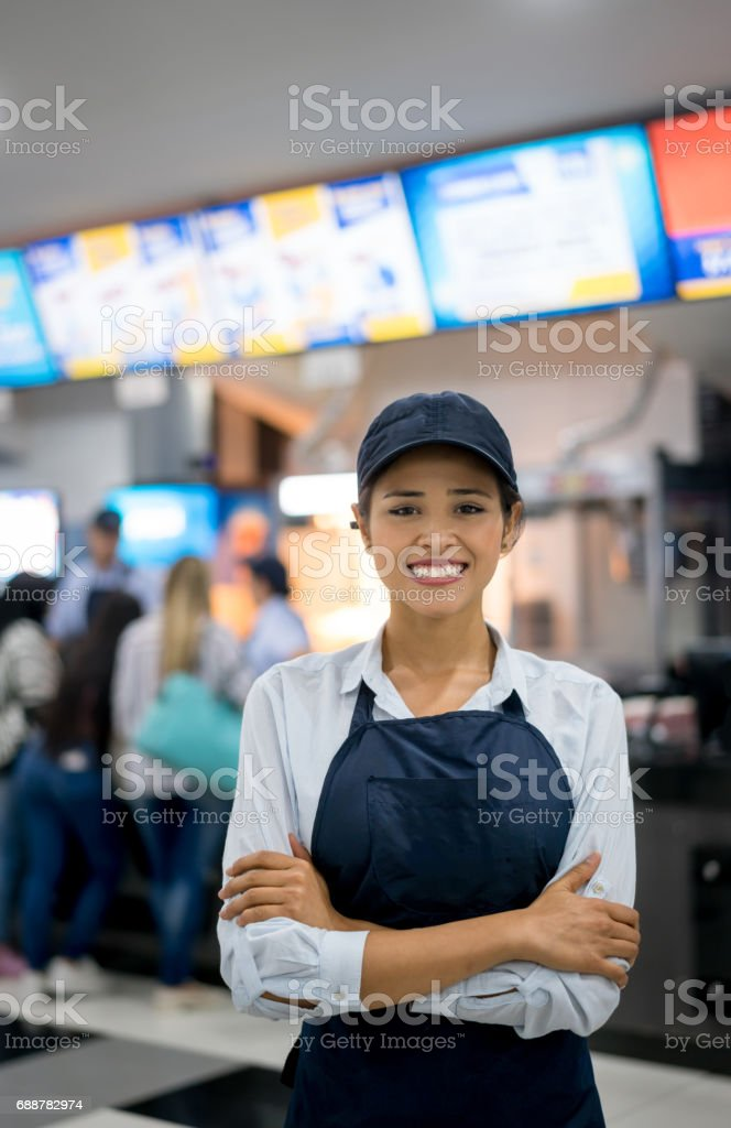 Portrait of a happy woman working at the movies stock photo