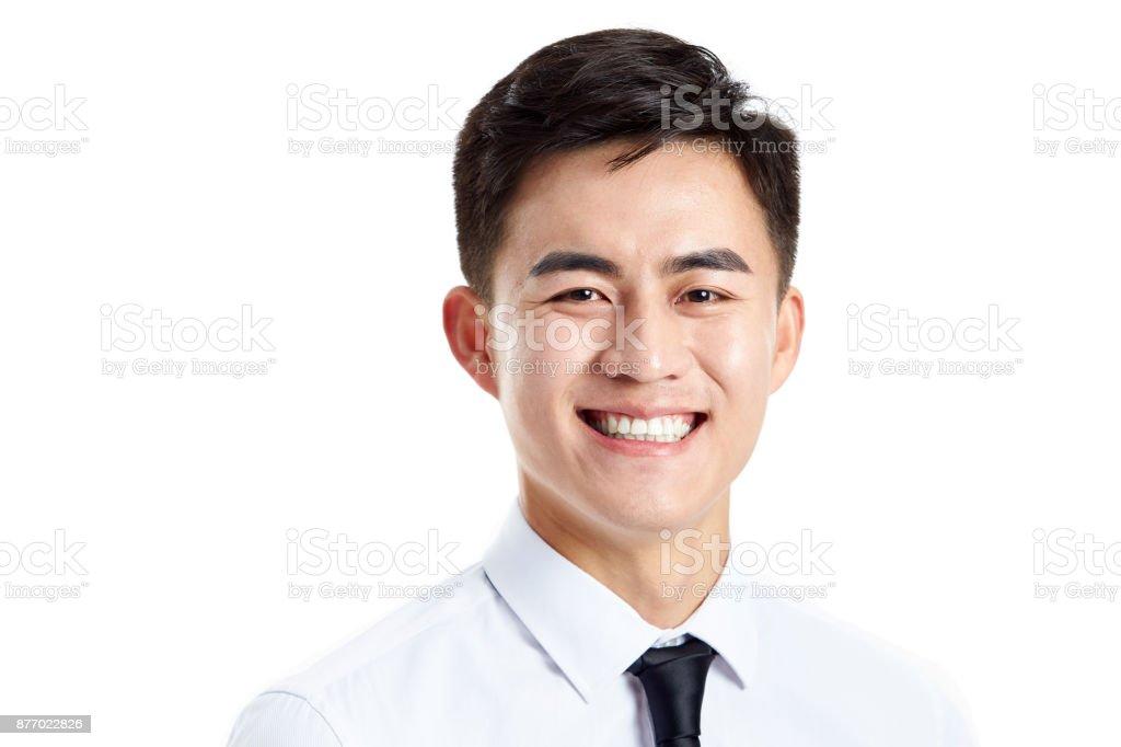 Portrait d'un homme d'affaires asiatique jeunes heureux photo libre de droits