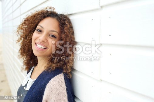 186534921 istock photo Portrait of a happy young attractive female smiling outdoors 185147845