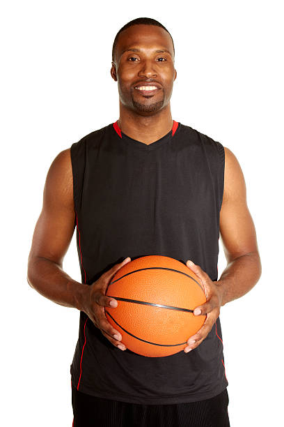 portrait of a happy young basketball player stock photo