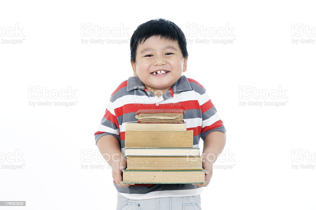 Portrait of a happy young boy carrying books royalty-free stock photo