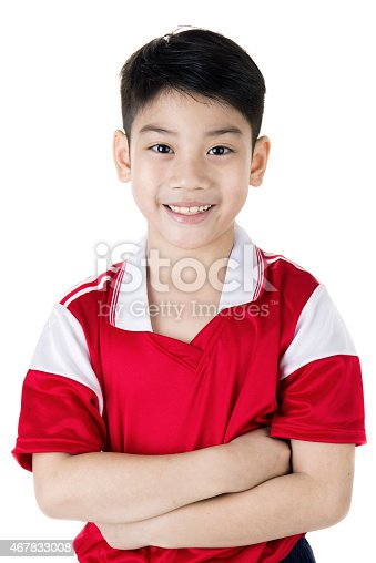 Portrait of Happy asian cute boy in red sport uniform on white background