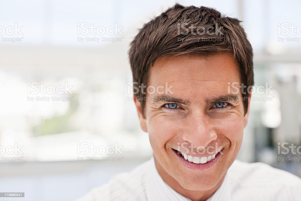 Portrait of a happy young busines man smiling royalty-free stock photo