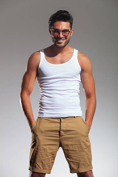 Man tank top pictures images and stock photos istock portrait of a happy young casual man stock photo urmus Choice Image