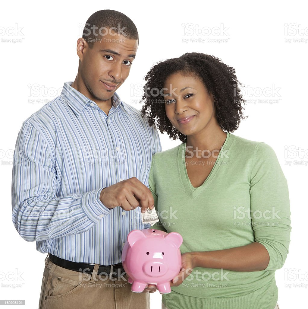 Portrait of a happy young couple with piggy bank stock photo