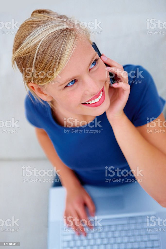 Portrait of a happy young girl using a laptop on white background royalty-free stock photo