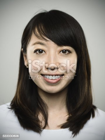 istock Portrait of a happy young japanese woman looking at camera 533330806