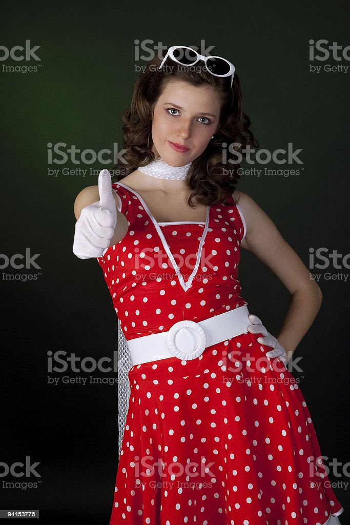 Portrait of a happy young lady showing thumb's up sign. royalty-free stock photo