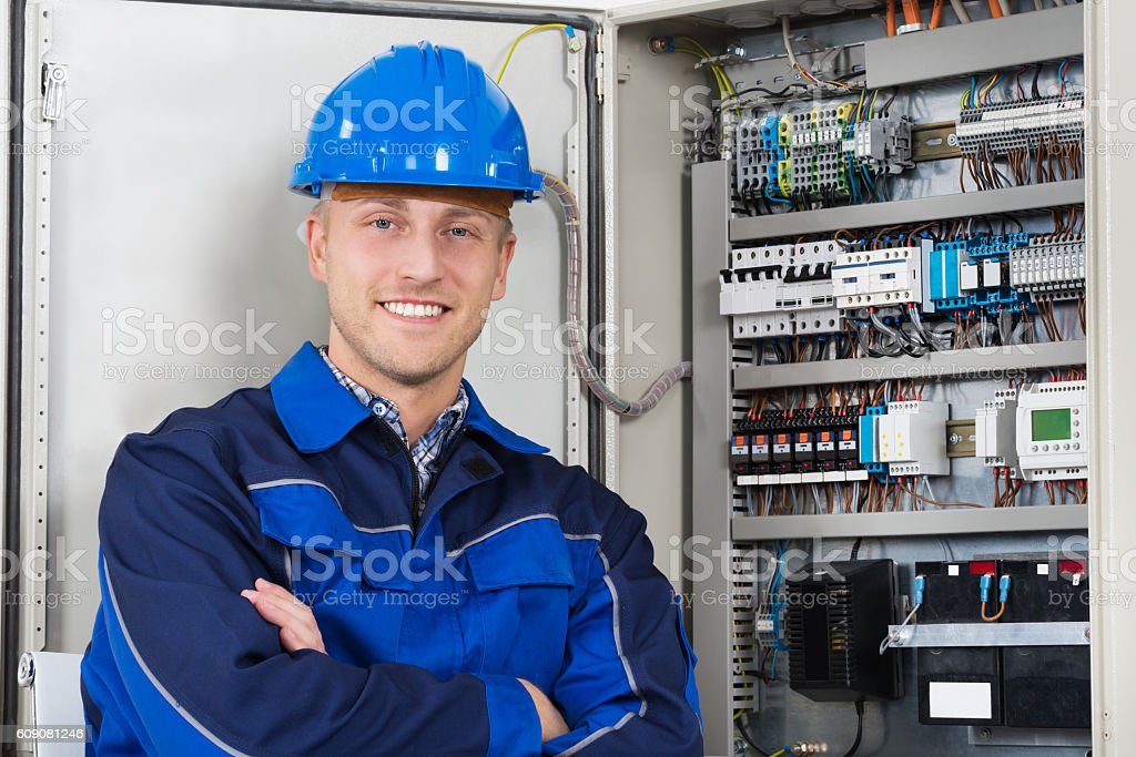 Portrait Of A Happy Young Male Electrician ストックフォト