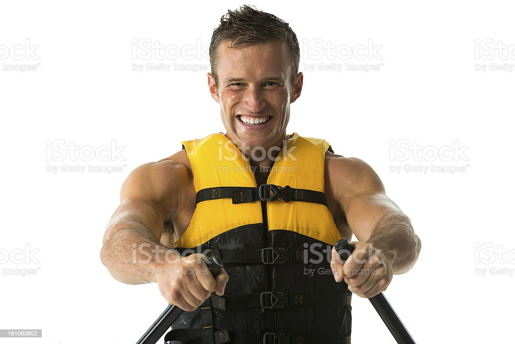 Portrait of a happy young man canoeing royalty-free stock photo
