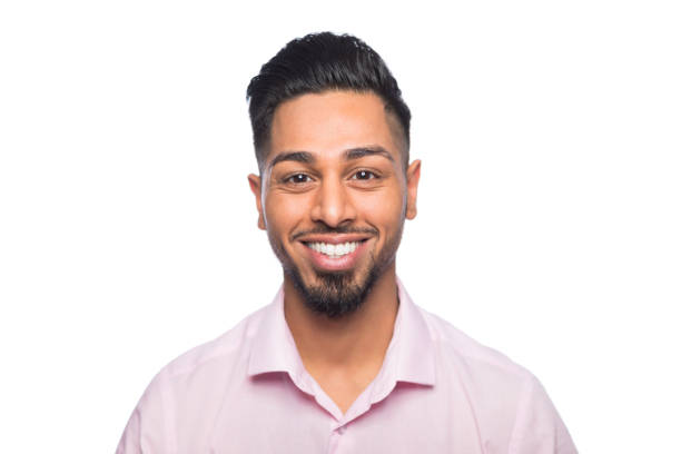 Portrait of a happy young man of asian ethnic descent stock photo