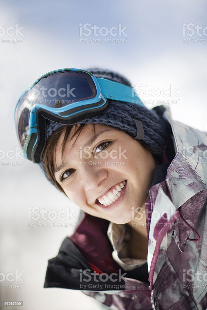 Portrait of a happy young woman in ski gear royalty-free stock photo