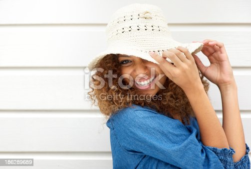 186534921 istock photo Portrait of a happy young woman wearing hat 186289689