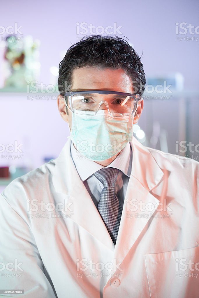 Portrait of a helth care professional in laboratory. stock photo