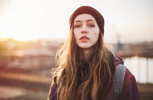 Portrait of a hipster girl at sunset stock photo