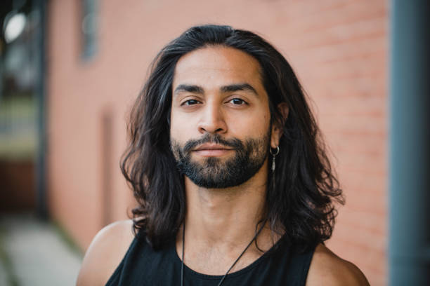 Portrait of a Hipster Man Close up portrait of a mid-adult mixed race man. long hair stock pictures, royalty-free photos & images