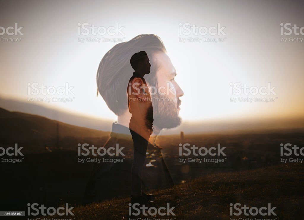 Portrait of a hipster with double exposure technique stock photo