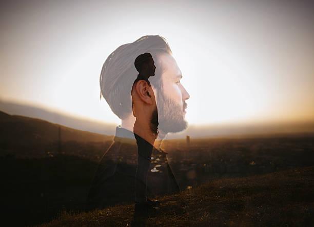 Portrait de hipster avec une double exposition technique - Photo