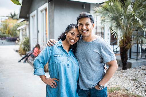Portrait of a loving, romantic hispanic couple outdoors