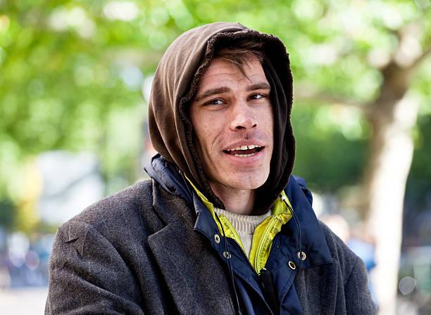 Portrait of a homeless man outside stock photo